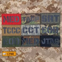 """Nine patches of USA Military Occupacional: all of them with size 2""""x3.5"""" in diferent fabrics and colors/texts"""