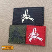 three patches with the image of a scorpion