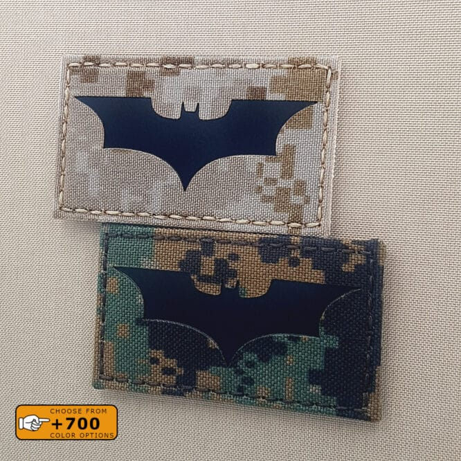 """Two patches with size 2""""x3.5"""" of the Batman logo: one in Aor 1 (Digital desert) background with IR and another one in Flecktarn background with IR"""